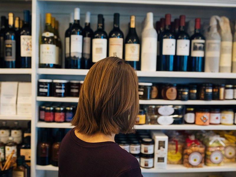 Oakville Grocery customer shopping for wine